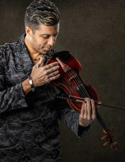 G Pinto - brown suit holding violin
