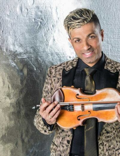 G Pinto - gold suit holding violin