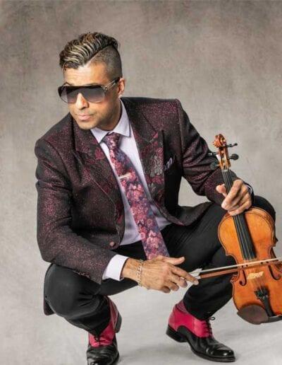 G Pinto - purple suit - squatting