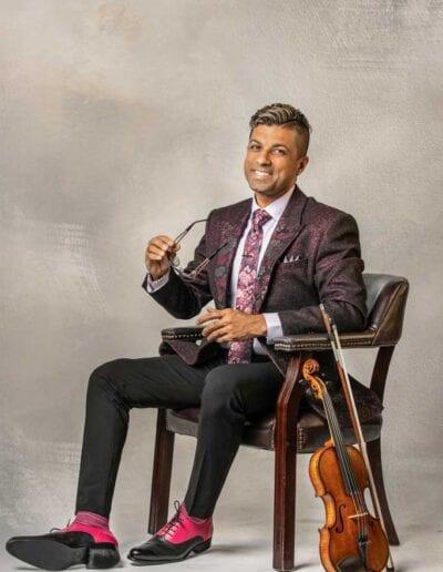 G Pinto - purple suit - smiling