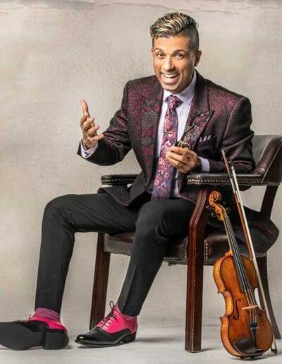 G Pinto - purple suit big smile